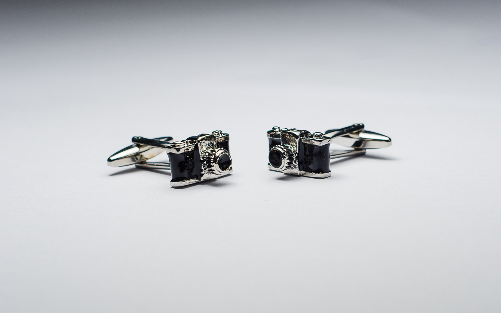 Cufflinks shaped like cameras